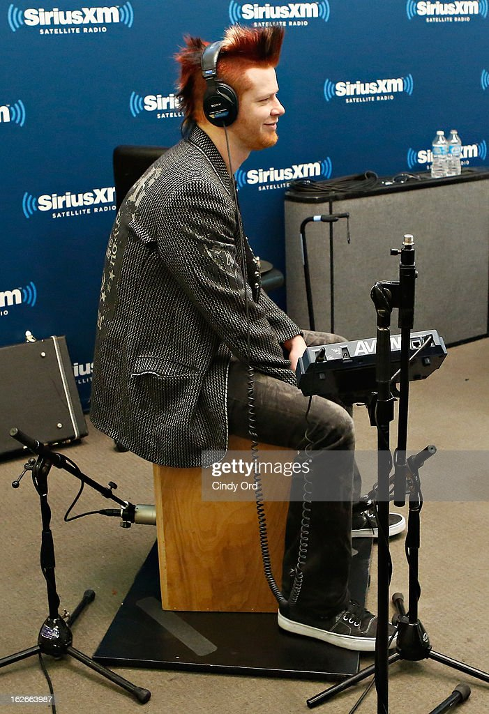 Drummer <a gi-track='captionPersonalityLinkClicked' href=/galleries/search?phrase=Cody+Hanson&family=editorial&specificpeople=3968769 ng-click='$event.stopPropagation()'>Cody Hanson</a> performs with Hinder at the SiriusXM Studios on February 25, 2013 in New York City.