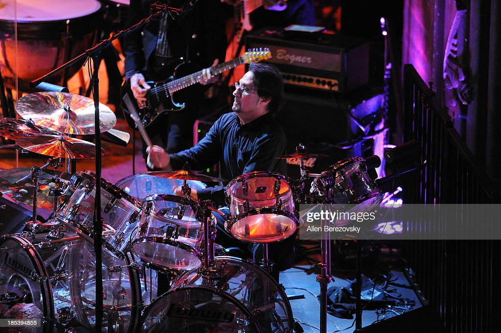 Drummer <a gi-track='captionPersonalityLinkClicked' href=/galleries/search?phrase=Dave+Lombardo&family=editorial&specificpeople=2006339 ng-click='$event.stopPropagation()'>Dave Lombardo</a> of Slayer performs during Varese Sarabande Worldwide 35th Anniversary Special Halloween Concert Gala at Warner Grand Theatre on October 19, 2013 in San Pedro, California.