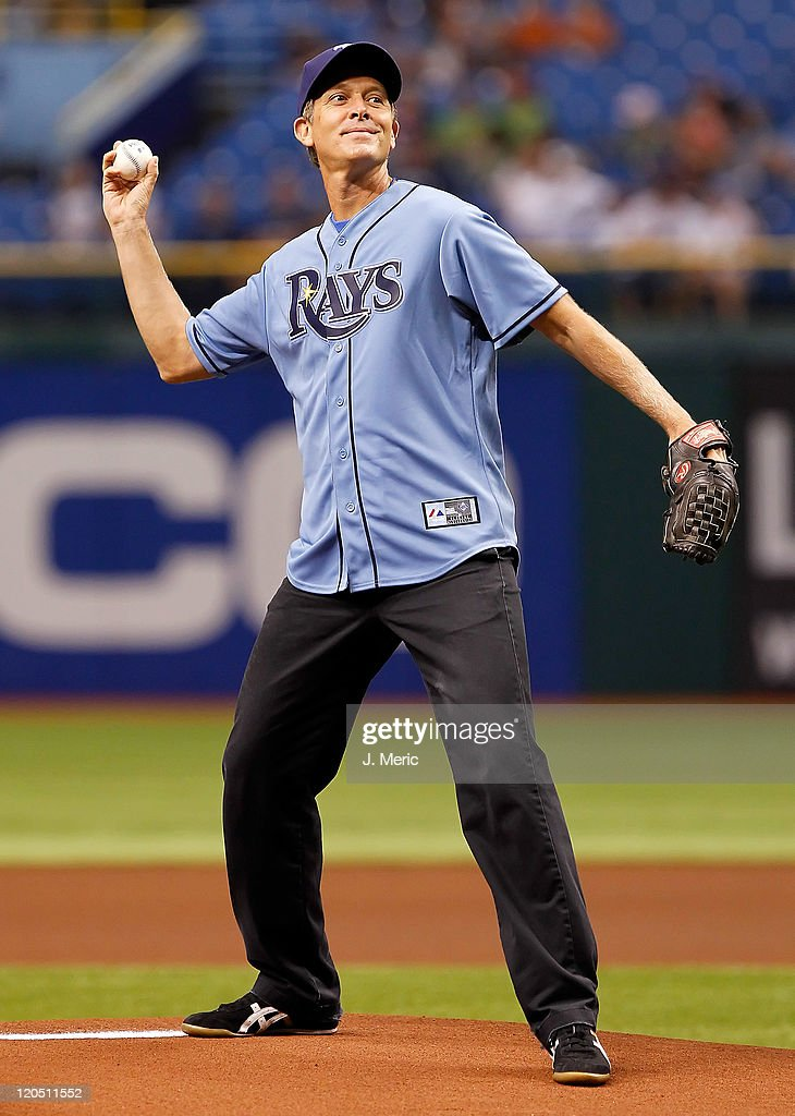 Drummer for the Goo Goo Dolls, Mike Malinin, throws out the ceremonial first pitch for the game between the Tampa Bay Rays and the Oakland Athletics at Tropicana Field on August 6, 2011 in St. Petersburg, Florida.