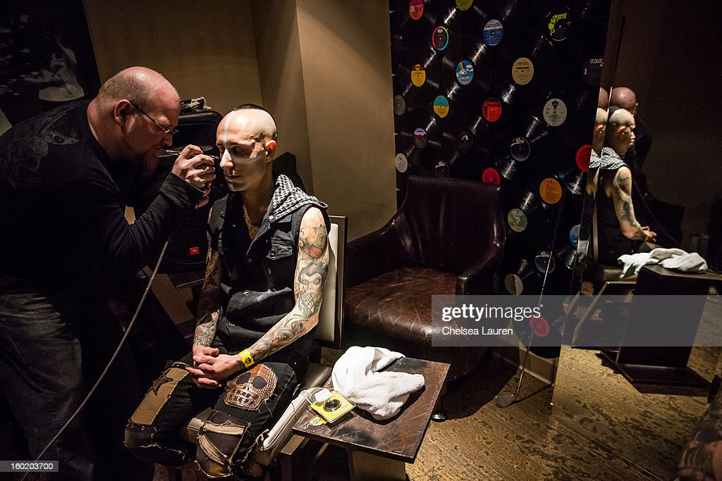 Drummer Frank Zummo prepares backstage at Street Drum Corps' 'Lost Vegas' show at Hard Rock Hotel and Casino on January 26, 2013 in Las Vegas, Nevada.