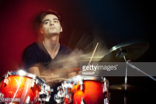 Drummer in motion playing drums