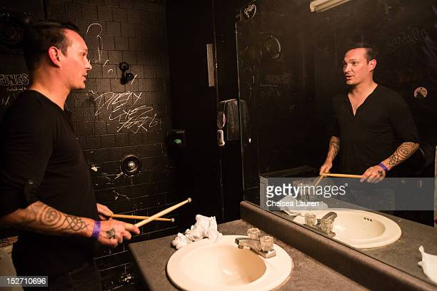 Drummer Jamie Miller of Orgy prepares backstage at The Roxy Theatre on September 23 2012 in West Hollywood California