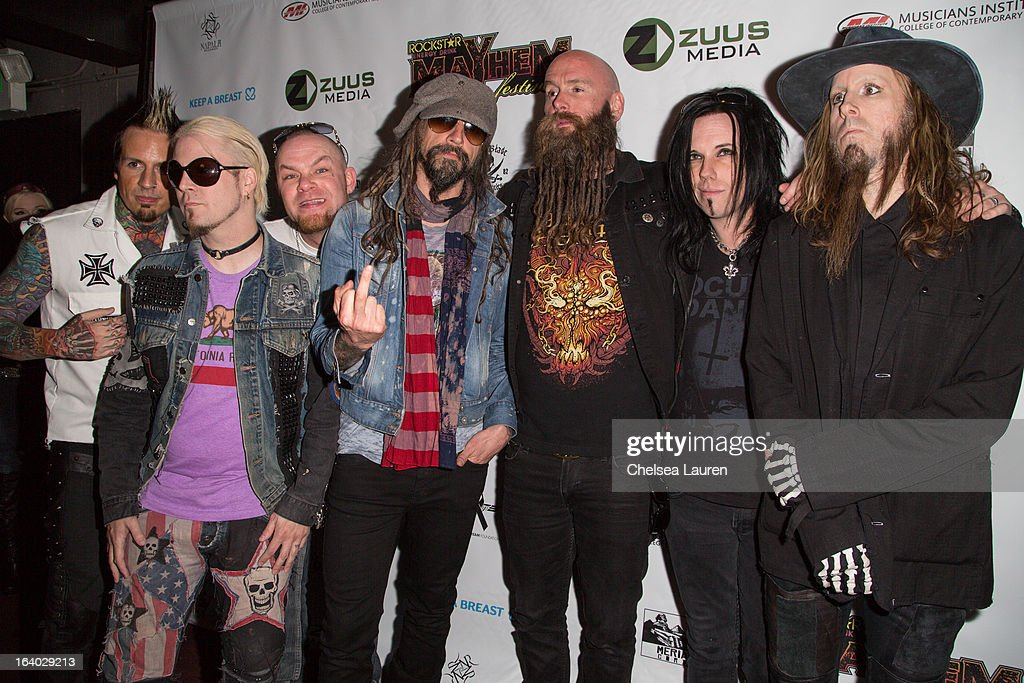 Drummer Jeremy Spencer, guitarist John 5, vocalist Ivan Moody, vocalist Rob Zombie, bassist Chris Kael, bassist Piggy D. and drummer Ginger Fish attend the 6th annual Rockstar energy drink Mayhem festival press conference at The Whiskey A Go Go on March 18, 2013 in West Hollywood, California.