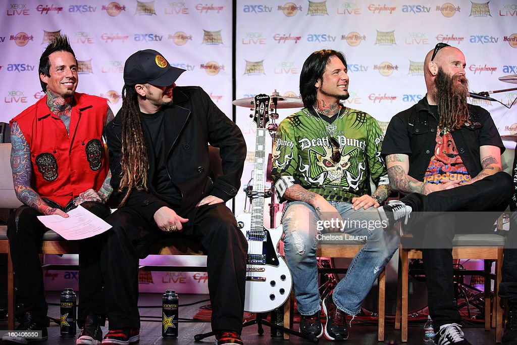 Drummer Jeremy Spencer, guitarist Zoltan Bathory, guitarist Jason Hook and bassist Chris Kael of Five Finger Death Punch attend the Revolver Golden Gods Awards press conference at Hard Rock Cafe - Hollywood on January 30, 2013 in Hollywood, California.