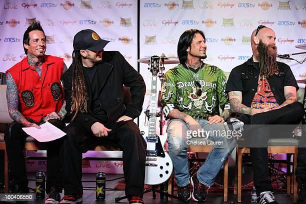 Drummer Jeremy Spencer guitarist Zoltan Bathory guitarist Jason Hook and bassist Chris Kael of Five Finger Death Punch attend the Revolver Golden...