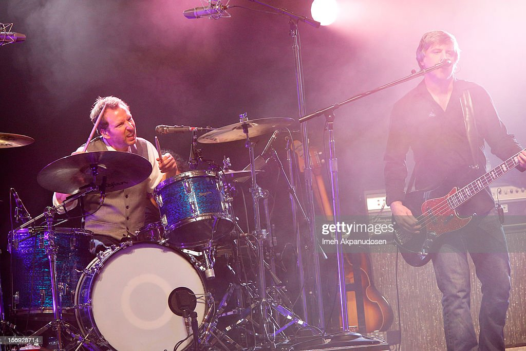 Drummer Jim Bogios (L) and musician Millard Powers of Counting Crows perform onstage at The Wiltern on November 24, 2012 in Los Angeles, California.