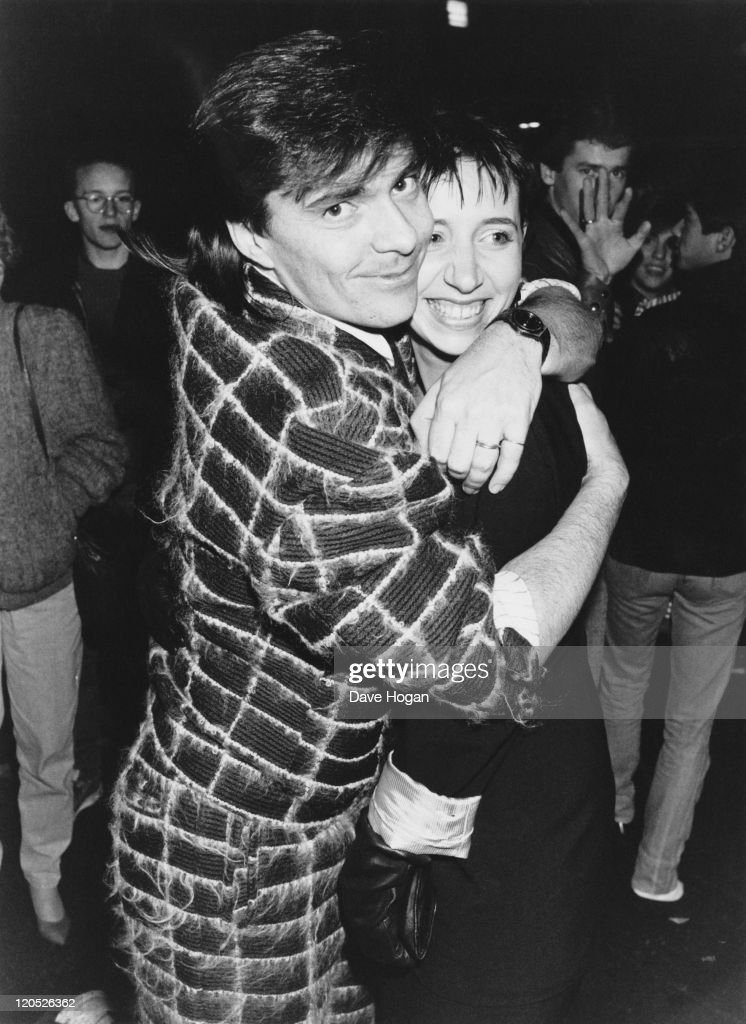 Drummer John Keeble, of British pop group Spandau Ballet, with his girlfriend 'Flea', at a party held by Prince Charles and Princess Diana at a recording studio in Oxford Street, London, 19th November 1985. The party is being held in recognition of the work done by pop musicians for the Prince's Trust charity.