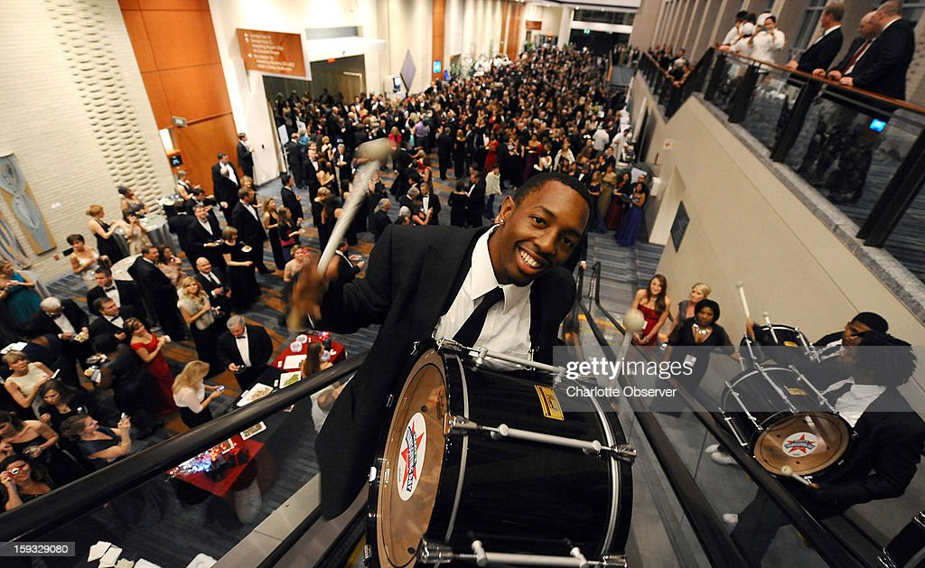 Drummer Jordan King with the North Carolina A&T University Cold Steel Drumline performs as he, and other members, ride up the escalators at the Raleigh Convention Center in Raleigh, North Carolina, Friday, January 11, 3013. The drumline performed for Gov. Pat McCrory during the Gala Presentation.