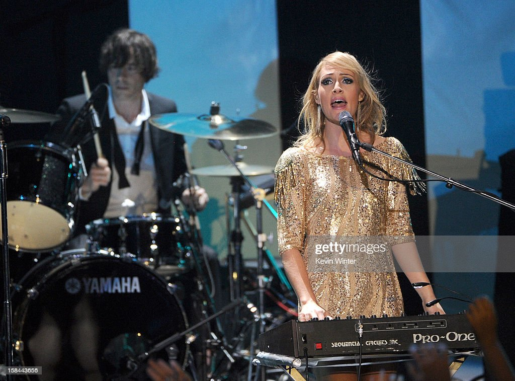 Drummer Joules Scott-Key and singer Emily Haines of Metric perform onstage during 'VH1 Divas' 2012 at The Shrine Auditorium on December 16, 2012 in Los Angeles, California.