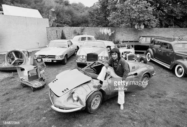 Drummer Keith Moon of British rock group The Who at Tara his home in Chersey Surrey with his daughter Amanda and some of the cars in his collection...