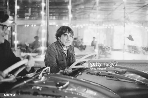 Drummer Keith Moon of English rock group The Who driving a dodgem car at a funfair in Felixstowe Suffolk before a concert 9th September 1966