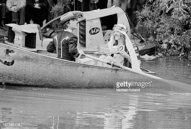 Drummer Keith Moon of The Who takes tea in a rowboat with a friend at the Crystal Palace Garden Party 3 at Crystal Palace Bowl London 3rd June 1972