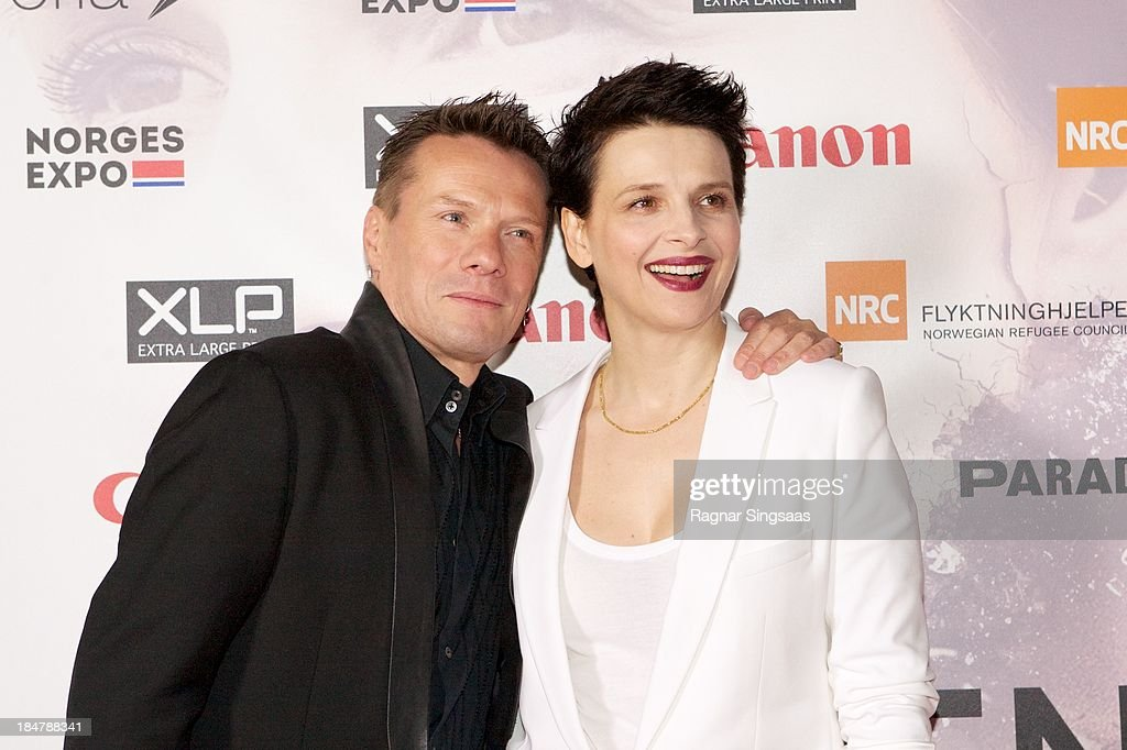 U2 drummer Larry Mullen Jr and actress <a gi-track='captionPersonalityLinkClicked' href=/galleries/search?phrase=Juliette+Binoche&family=editorial&specificpeople=209273 ng-click='$event.stopPropagation()'>Juliette Binoche</a> attend the Oslo premiere of 'A Thousand Times Good Night' at Colosseum on October 16, 2013 in Oslo, Norway.
