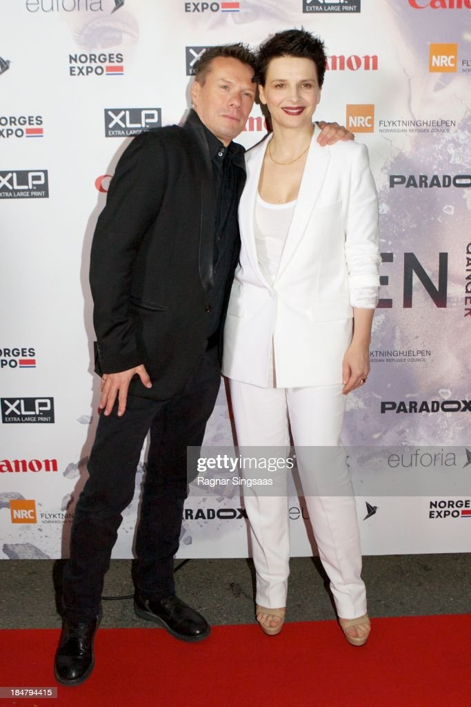 U2 drummer Larry Mullen Jr and actress Juliette Binoche attend the Oslo premiere of 'A Thousand Times Good Night' at Colosseum on October 16, 2013 in Oslo, Norway.
