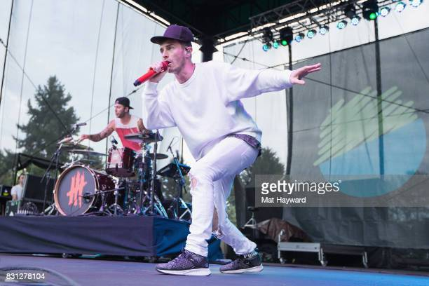 Drummer Louis Vecchio and singer David Boyd of New Politics perform on stage during the Summer Camp Music Festival hosted by 1077 The End at Marymoor...