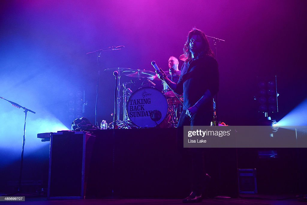 Drummer Mark O'Connell and Singer <a gi-track='captionPersonalityLinkClicked' href=/galleries/search?phrase=Adam+Lazzara&family=editorial&specificpeople=2152821 ng-click='$event.stopPropagation()'>Adam Lazzara</a> of Taking Back Sunday performs at Sands Bethlehem Event Center on April 19, 2014 in Bethlehem, Pennsylvania.