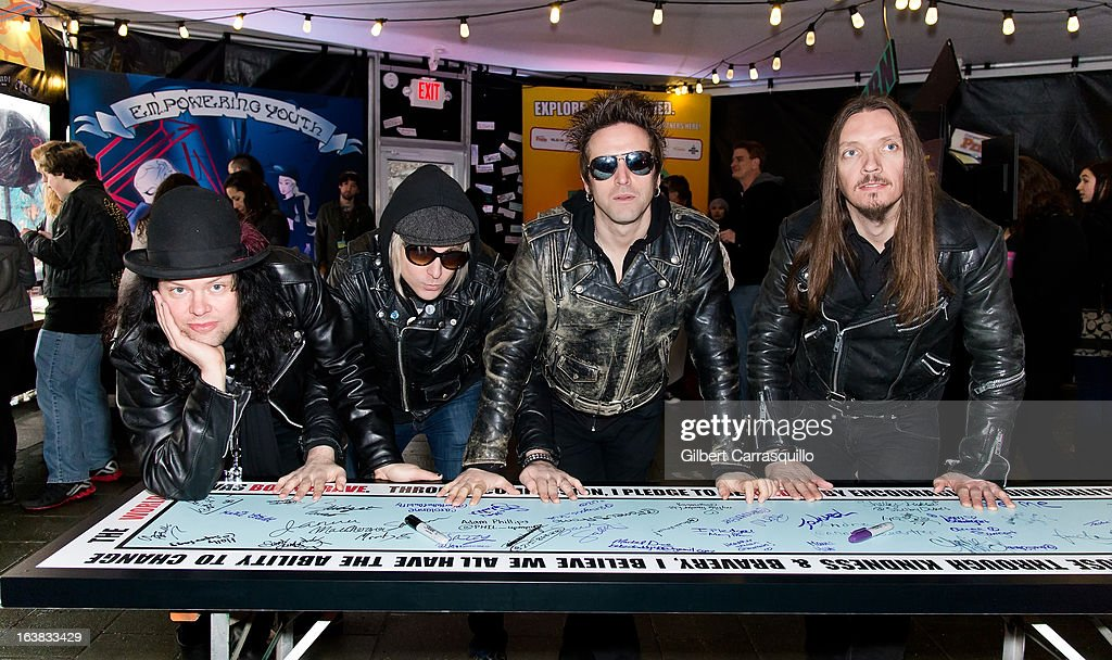 Drummer Marty E., guitarist Sunny Climbs, vocalist Tommy London and bass guitarist Dougie Wright of The Dirty Pearls attend Lady Gaga's Born This Way Bus Tour at Philadelphia Museum of Art on March 16, 2013 in Philadelphia City.