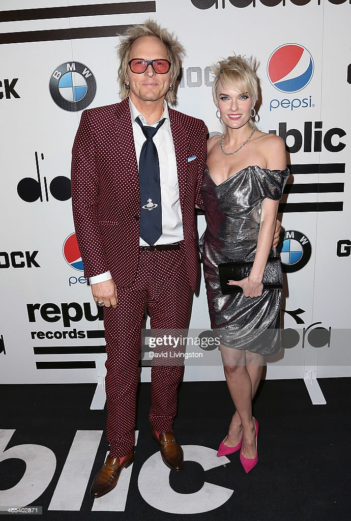 Drummer <a gi-track='captionPersonalityLinkClicked' href=/galleries/search?phrase=Matt+Sorum&family=editorial&specificpeople=213836 ng-click='$event.stopPropagation()'>Matt Sorum</a> (L) and wife Adriane 'Ace' Harper attend Republic Records Post Grammy Party at 1 OAK on January 26, 2014 in West Hollywood, California.