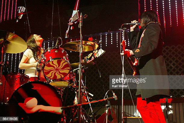 Drummer Meg White and guitarist Jack White of The White Stripes performs at night two of 1067 KROQ's 'Almost Acoustic Christmas' at Gibson...