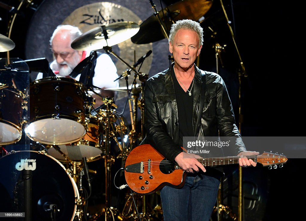 Drummer <a gi-track='captionPersonalityLinkClicked' href=/galleries/search?phrase=Mick+Fleetwood&family=editorial&specificpeople=209055 ng-click='$event.stopPropagation()'>Mick Fleetwood</a> (L) and singer/guitarist <a gi-track='captionPersonalityLinkClicked' href=/galleries/search?phrase=Lindsey+Buckingham&family=editorial&specificpeople=238836 ng-click='$event.stopPropagation()'>Lindsey Buckingham</a> of Fleetwood Mac perform at the MGM Grand Garden Arena on May 26, 2013 in Las Vegas, Nevada.