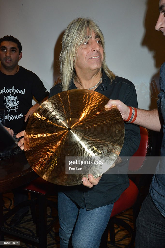 Drummer Mickey Dee from Motorhead band receives a Golden Cymbal award during 'Motorheadphones' Press Conference at the Hard Rock Cafe on November 22, 2012 in Paris, France.