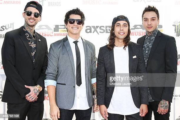 Drummer Mike Fuentes bassist Jaime Preciado vocalist Vic Fuentes and guitarist Tony Perry of Pierce the Veil attend the 2014 Gibson Brands AP Music...