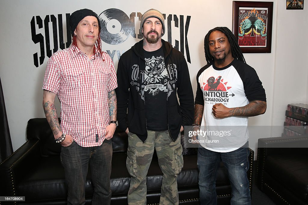 Drummer Morgan Rose, guitarist John Connolly and vocalist Lajon Witherspoon of Sevendust attend the in-store signing and meet and greet celebrating the release of their album 'Black Out The Sun' at SoundCheck Hollywood on March 26, 2013 in West Hollywood, California.