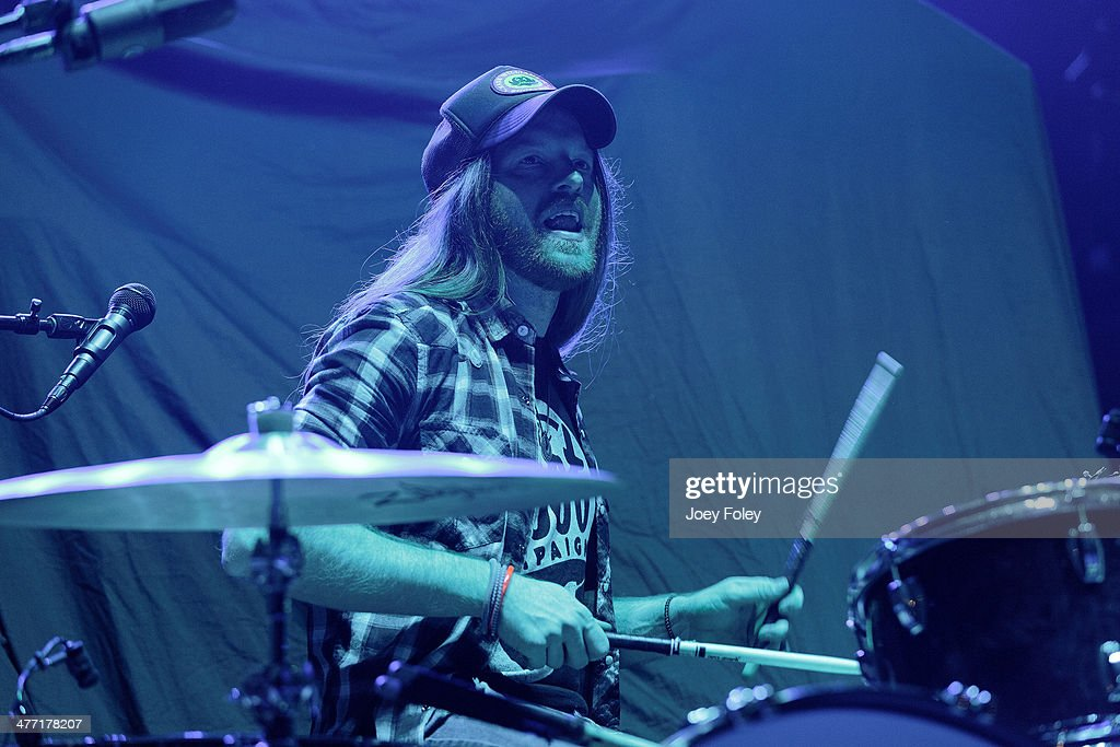 Drummer Neil Mason of The Cadillac Three performs onstage at Bankers Life Fieldhouse on February 15, 2014 in Indianapolis, Indiana.