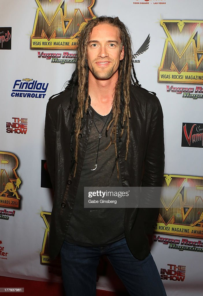 Drummer Nick Oshiro arrives at the 2013 Vegas Rocks! magazine music awards at The Joint inside the Hard Rock Hotel & Casino on August 25, 2013 in Las Vegas, Nevada.