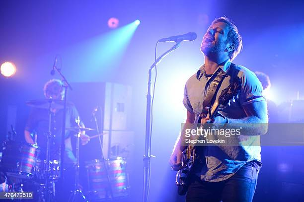 Drummer Patrick Carney and singer Dan Auerbach of The Black Keys perform onstage during the iHeartRadio LIVE performance and QA with The Black Keys...