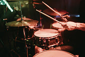 Drummer playing his drum kit on concert