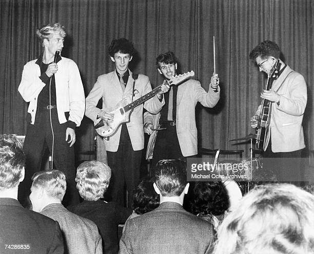 Drummer Ringo Starr of the rock and roll band 'The Beatles' performs onstage with 'Rory Storm the Hurricanes' at the Jive Hive aka St Lukes Church...