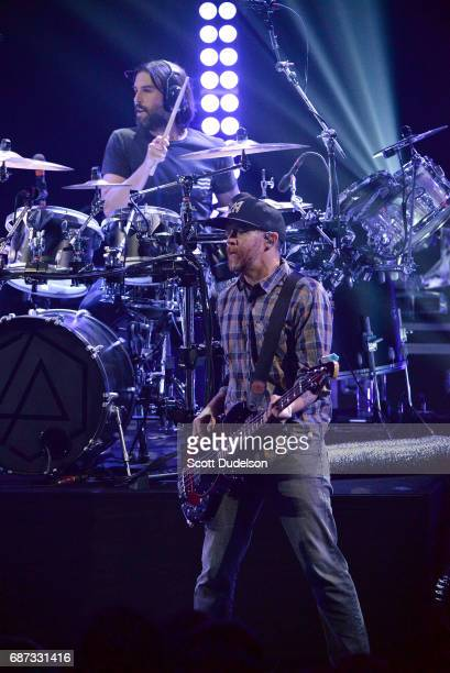 Drummer Rob Bourdon and bass player Dave Farrell of Linkin Park perform onstage during the band's 'One More Light' album release party at the...