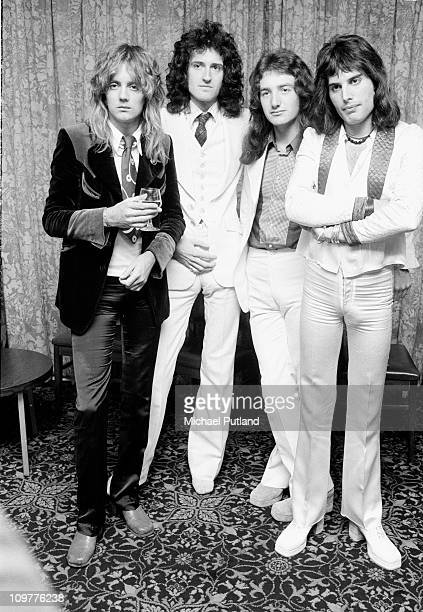 Drummer Roger Taylor guitarist Brian May bassist John Deacon and singer Freddie Mercury of British rock band Queen pose in September 1974