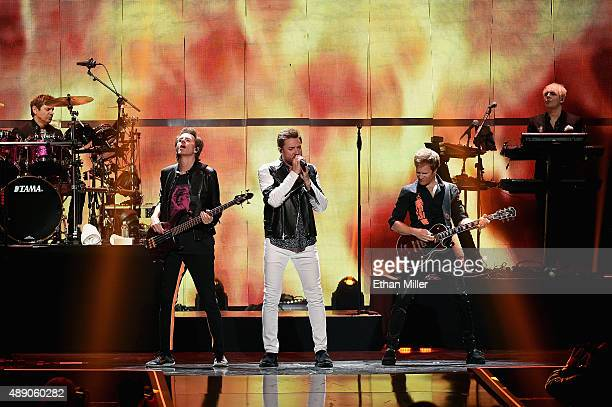 Drummer Roger Taylor guitarist John Taylor singer Simon Le Bon touring guitarist Dom Brown and keyboardist Nick Rhodes of Duran Duran perform onstage...