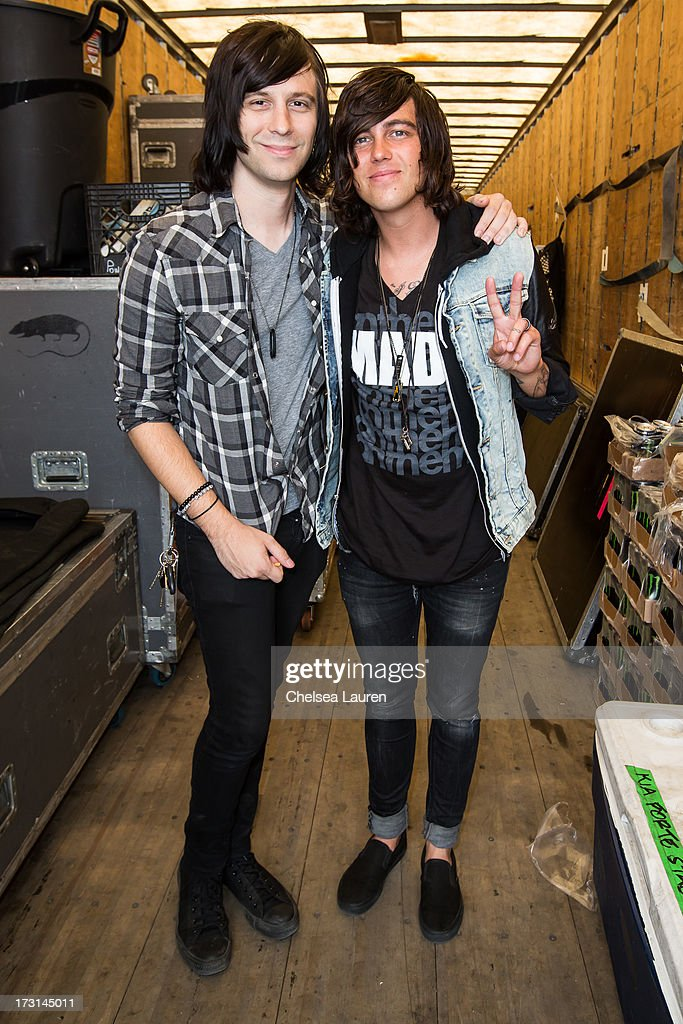 Drummer Ryan Seaman of Falling in Reverse (L) and vocalist Kellin Quinn of Sleeping With Sirens backstage at the Vans Warped Tour on June 23, 2013 in Ventura, California.
