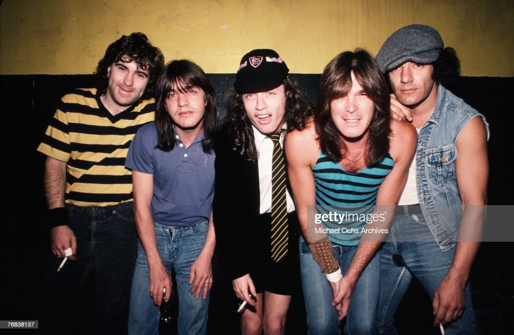 Drummer Simon Wright, rhythm guitarist Malcolm Young, lead guitarist Angus Young, bassist Cliff Williams, and singer Brian Johnson of AC/DC pose backstage before a show at the Forum on October 18, 1985, in Inglewood, California.