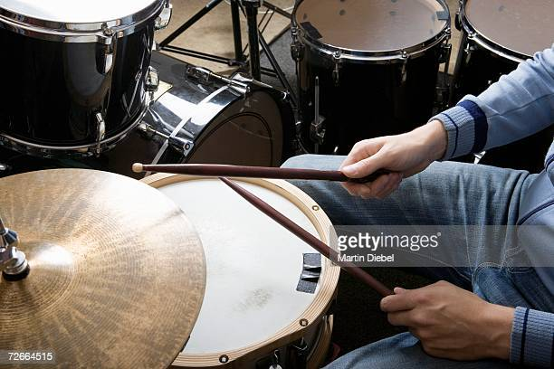 Drummer sitting at drum kit