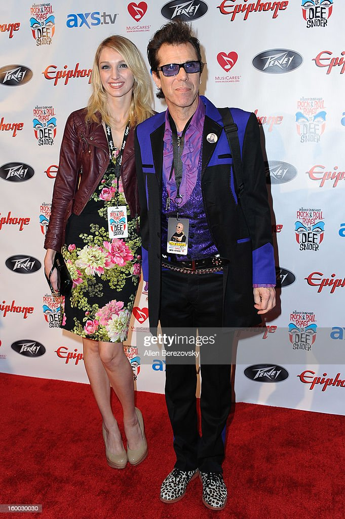 Drummer Slim Jim Phantom (R) and a guest arrive at the Revolver/Guitar World Rock & Roll roast of Dee Snider at City National Grove of Anaheim on January 24, 2013 in Anaheim, California.