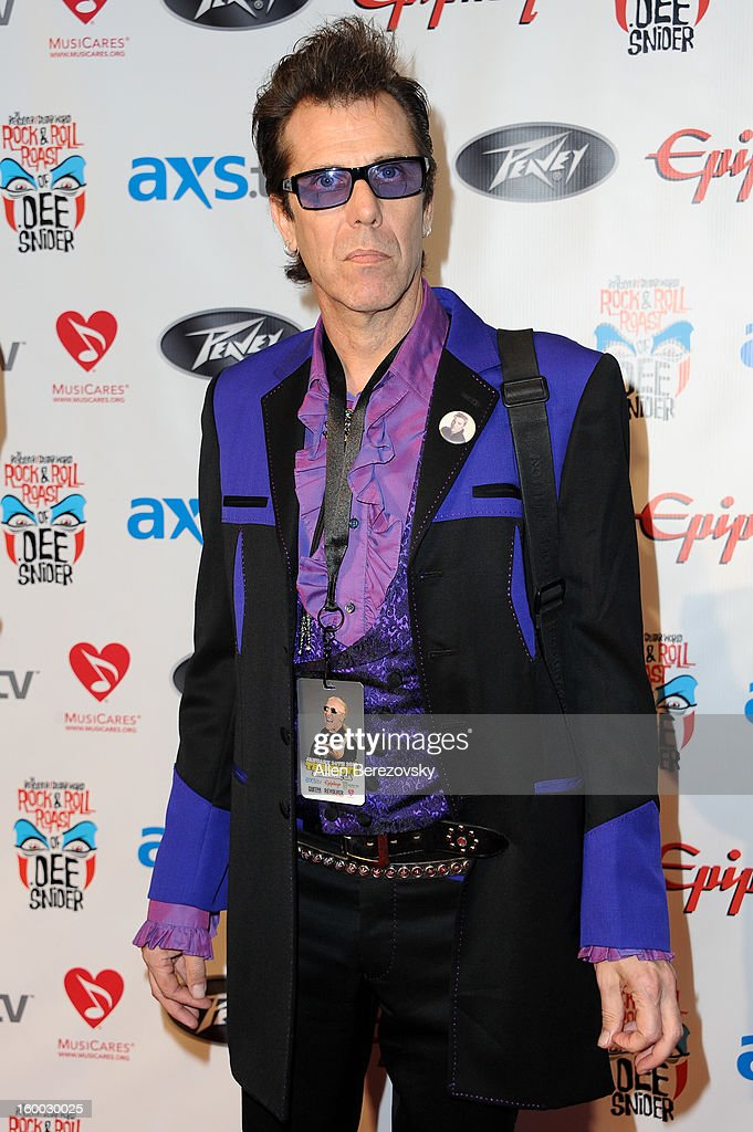 Drummer Slim Jim Phantom arrives at the Revolver/Guitar World Rock & Roll roast of Dee Snider at City National Grove of Anaheim on January 24, 2013 in Anaheim, California.