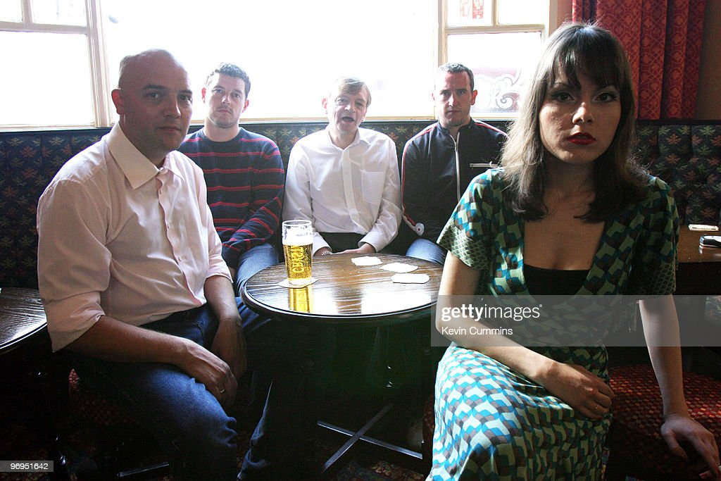 Drummer Spencer Birtwistle, guitarist Ben Pritchard, singer-songwriter Mark E. Smith, bassist Steve Trafford and Elena Poulou of British band The Fall sit in a pub on August 15, 2006.