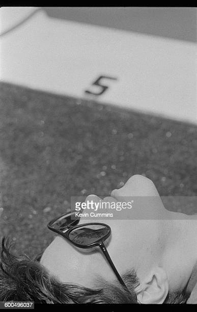 Drummer Stephen Morris of English rock group New Orderrelaxing by a swimming pool Washington DC 9th July 1983