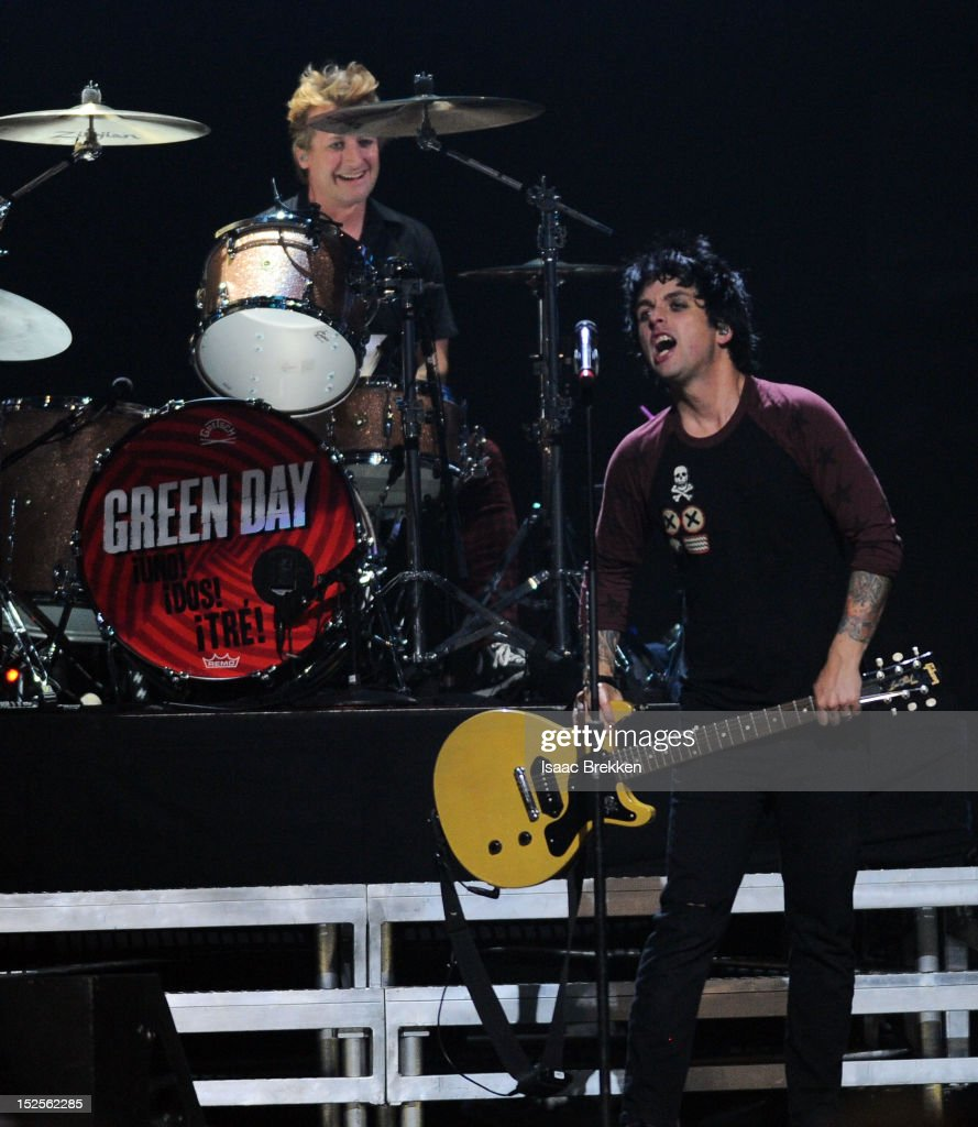 Drummer Tre Cool (L) and frontman <a gi-track='captionPersonalityLinkClicked' href=/galleries/search?phrase=Billie+Joe+Armstrong&family=editorial&specificpeople=201545 ng-click='$event.stopPropagation()'>Billie Joe Armstrong</a> of Green Day perform onstage during the 2012 iHeartRadio Music Festival at the MGM Grand Garden Arena on September 21, 2012 in Las Vegas, Nevada.