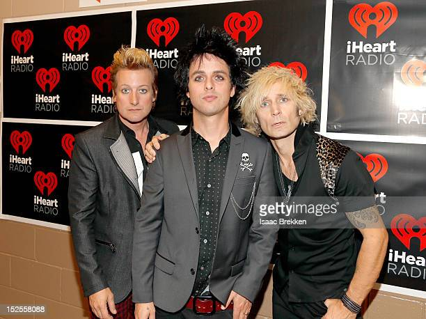 Drummer Tre Cool frontman Billie Joe Armstrong and bassist Mike Dirnt appear backstage during the 2012 iHeartRadio Music Festival at the MGM Grand...