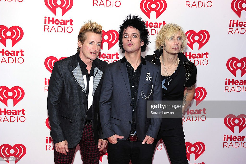 Drummer Tre Cool, frontman <a gi-track='captionPersonalityLinkClicked' href=/galleries/search?phrase=Billie+Joe+Armstrong&family=editorial&specificpeople=201545 ng-click='$event.stopPropagation()'>Billie Joe Armstrong</a> and bassist <a gi-track='captionPersonalityLinkClicked' href=/galleries/search?phrase=Mike+Dirnt&family=editorial&specificpeople=204154 ng-click='$event.stopPropagation()'>Mike Dirnt</a> of the band Green Day pose in the press room at the iHeartRadio Music Festival at the MGM Grand Garden Arena September 21, 2012 in Las Vegas, Nevada.