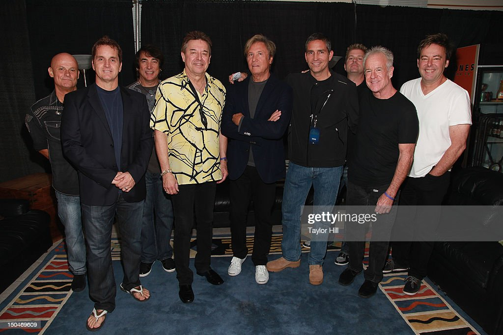 Drummer Tris Imboden, bassist Jason Scheff, percussionist Walfredo Reyes, saxophonist Walter Parazaider, keyboardist Robert Lamm, actor Jim Caviezel, guitarist Keith Howland, trombonist James Pankow, and keyboardist Lou Pardini at Nikon at Jones Beach Theater on August 18, 2012 in Wantagh, New York.
