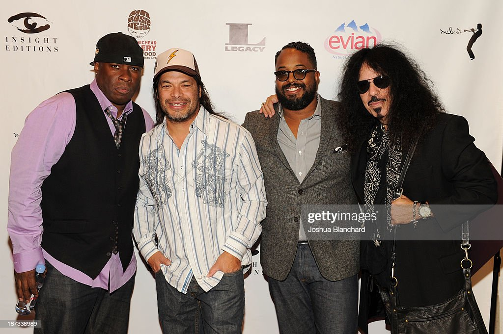 Drummer Vince Wilburn Jr., bassist <a gi-track='captionPersonalityLinkClicked' href=/galleries/search?phrase=Robert+Trujillo&family=editorial&specificpeople=213071 ng-click='$event.stopPropagation()'>Robert Trujillo</a>, Erin Davis and drummer Frankie Banali arrive at Mr. Musichead Gallery for the 'Miles Davis: The Collected Artwork' Launch Party on November 7, 2013 in Los Angeles, California.