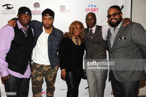 Drummer Vince Wilburn Jr rapper Nas Cheryl Davis Actor Don Cheadle and Erin Davis arrive at Mr Musichead Gallery for the 'Miles Davis The Collected...