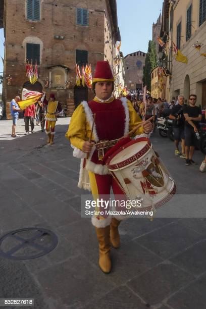 A drummer walks with the cortege ahead of today's Palio on August 16 2017 in Siena Italy The Palio is the most famous event in Siena and is a horse...