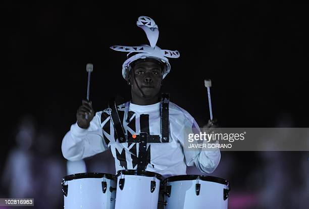 A drummer wearing a makarapa performs during the closing ceremony of the 2010 FIFA football World Cup prior to the final between the Netherlands and...